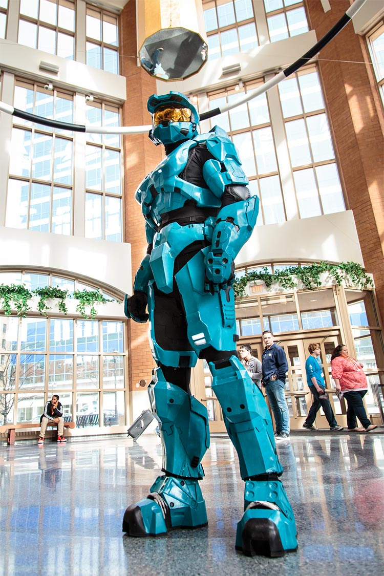 """Cosplayer Marc Nabke constructed this costume himself, based on a character from the video game Halo. Lots of people wanted to take his picture. This was his fourth year attending AMKE and he said part of the appeal of the convention experience was that he felt like he """"was part of the show myself. I work with the same eight people every day, so this is a great chance to meet new people that are into the same things you are and bond. I've seen a lot of familiar faces and friends here."""""""