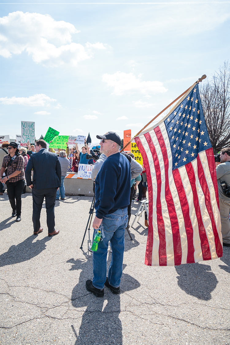 """At one point, protesters and Trump supporters were converging, arguing with each other outside the concrete barrier of the protest zone. We heard one confused police officer ask another, """"Is this a new line forming?"""" The other officer replied, """"No, um...democracy in action, or something like that."""""""